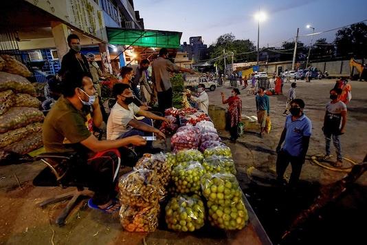 Vendors at Okhla vegetable market in New Delhi. (PTI)