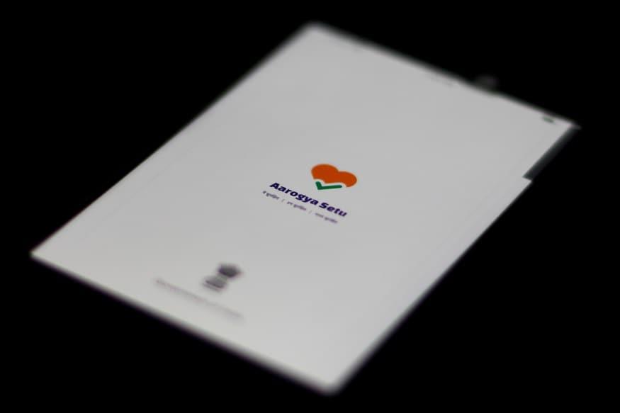 A photo illustration of the Aarogya Setu app logo