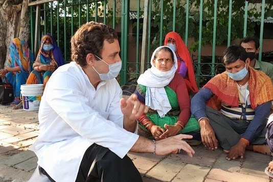Congress leader Rahul Gandhi interacts with migrant labourers in New Delhi.