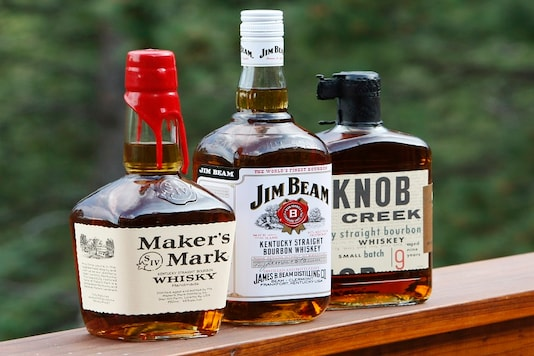 Three bourbon whiskeys, all owned by Fortune Brands including (L-R) Maker's Mark, Jim Beam and Knob Creek, are displayed in Golden, Colorado. (Reuters)