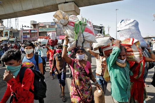 Migrant workers carrying their belongings walk back to their shelter after they heard that no train is scheduled for today to their home state of central Chhattisgarh, after a limited reopening of India's giant rail network following a nearly seven-week lockdown to slow the spread of the coronavirus disease (COVID-19), in Ahmedabad, India, May 17, 2020. REUTERS/Amit Dave
