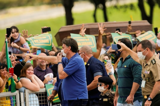 Brazil's President Jair Bolsonaro greets supporters during a protest against the President of the Chamber of Deputies Rodrigo Maia, Brazilian Supreme Court, quarantine and social distancing measures, amid the coronavirus disease outbreak, in Brasilia, Brazil on May 17, 2020. (Photo: REUTERS/Adriano Machado)