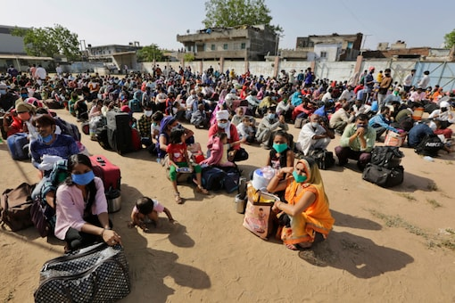 Migrant workers wait for trains to be ferried back to their home states. (AP Photo/Ajit Solanki)