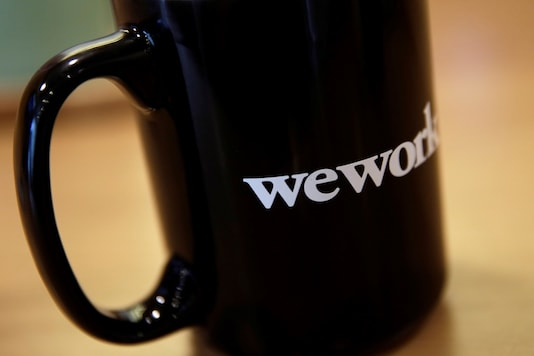 The WeWork logo is seen on a cup at a WeWork office in Beijing, China August 2, 2019. REUTERS/Jason Lee/Files