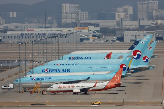 Korean Air's passenger planes are parked at on the tarmac as overseas flight routes are reduced following the outbreak of coronavirus disease (COVID-19), at Incheon International Airport in Incheon, South Korea. (Pic Source: Reuters)