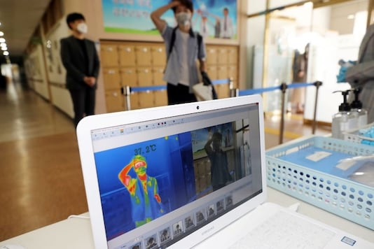 A student gets his temperature checked with a thermal imaging camera as a high school reopens, following the global outbreak of coronavirus disease (COVID-19), in Chungju, South Korea, May 20, 2020. (Yonhap/via REUTERS)