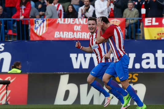 Diego Godin (R) and Saul Niguez (Photo Credit: Reuters)