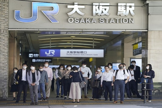 Commuters wearing protective masks head to work amid the coronavirus disease (COVID-19) outbreak in Osaka, Japan in this photo taken by Kyodo on May 21, 2020. Mandatory credit Kyodo/via REUTERS