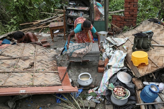 Residents salvage their belongings from the rubble of a damaged house in Bengal's South 24 Parganas district on Friday. (Reuters)