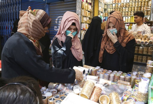 For representation: Women shop for the Eid holiday that marks the end of the Muslim holy fasting month of Ramadan after the government relaxed a weeks-long lockdown that was enforced to help curb the spread of the coronavirus, in Karachi, Pakistan. (Image: AP)