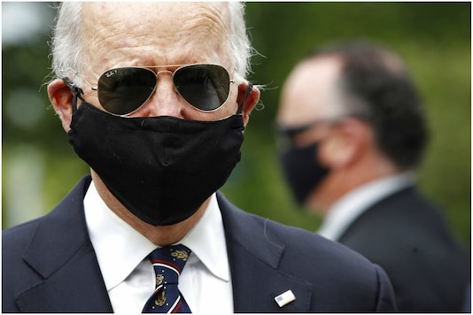 File photo: Democratic presidential candidate, and former Vice President Joe Biden wears a face mask to protect against the spread of the new coronavirus as he and Jill Biden arrived to place a wreath at the Delaware Memorial Bridge Veterans Memorial Park, in New Castle. (Image: AP)