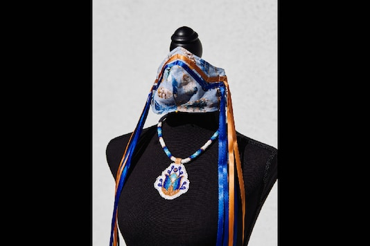A Navajo-inspired PPE mask and necklace created by Brighid Pulskamp is displayed in La Habra, California on May 14, 2020. The mask and necklace will be auctioned for the UCLA American Indian Alumni Association's scholarship fund. (Adam Amengual/The New York Times)