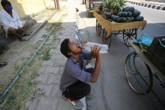 A vendor drinks water on a summer day in Jammu. (AP)
