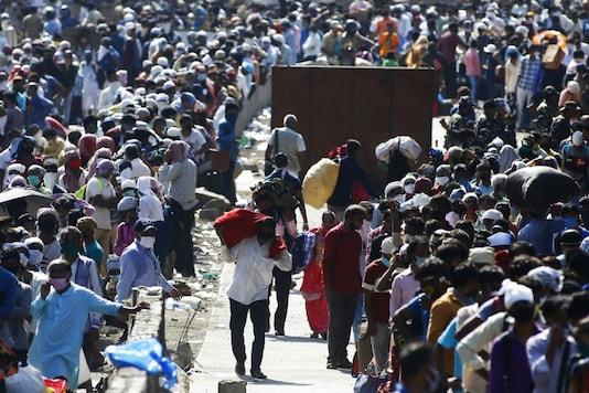 Migrants crowd Mumbai railway station.