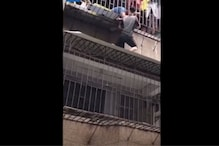 Daredevil Delivery Man in China Scales Two Storeys to Save Toddler Dangling from Window