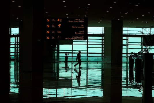 FILE PHOTO: A worker cleans the floor of the newly built Islamabad International Airport, during a media tour  ahead of its official opening, Pakistan April 18, 2018. REUTERS/Faisal Mahmood