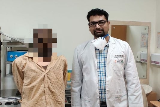 Dr Saurabh Gupta with the patient.
