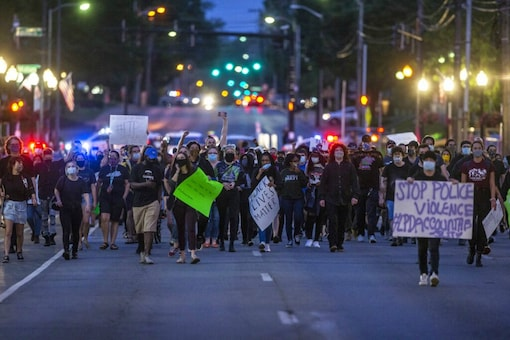 Protesters calling for an end to police violence walk through downtown. (Image: AP)