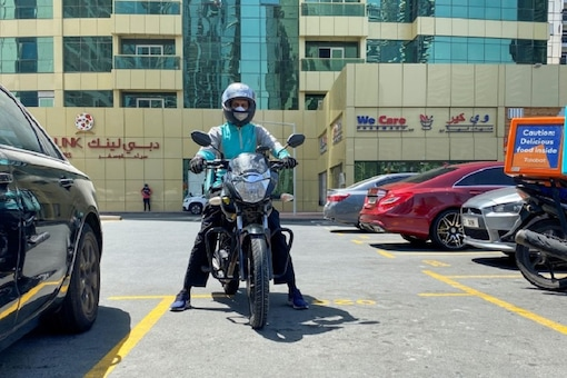 A food delivery worker rides a motorbike to deliver meal orders, following the outbreak of the coronavirus disease (COVID-19), in Dubai, United Arab Emirates, May 14, 2020. Picture taken May 14, 2020. (REUTERS/Abdel Hadi Ramahi)