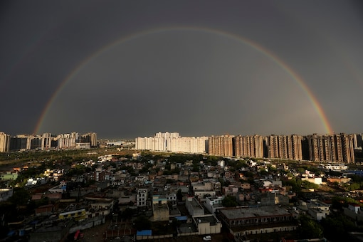 File photo of a rainbow appearing on the horizon after a brief spell of rain on the outskirts of New Delhi. (AP)