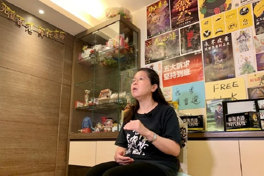 Office worker Daisy Lam speaks to Reuters about her experience in joining the annual June 4 candlelight vigil, at her living room in Hong Kong, China June 1, 2020. Picture taken June 1, 2020.  REUTERS/Yoyo Chow