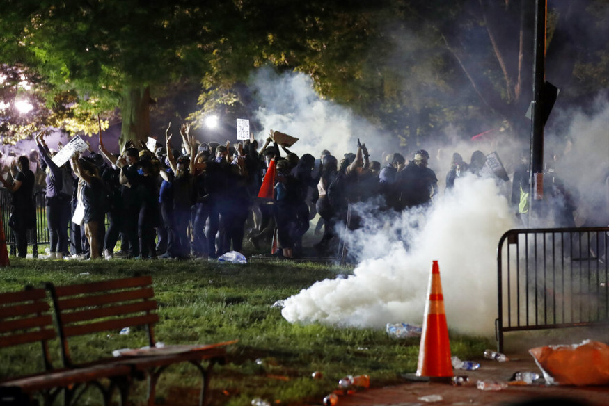 Tear gas billows as demonstrators gather in Lafayette Park to protest the death of George Floyd, near the White House in Washington. (Image: AP)
