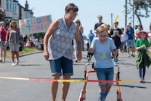 9-Year-Old Boy with Cerebral Palsy Completes Marathon Run on Walker for Charity