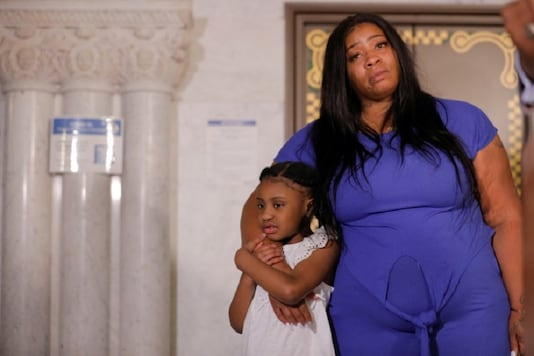 George Floyd's 6-year-old daughter, Gianna, is embraced by her mother, Roxie Washington, before speaking about her father, following his death in Minneapolis police custody, at the Minneapolis City Hall, in Minneapolis, U.S., June 2, 2020. REUTERS/Lucas Jackson