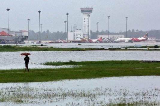 FILE PHOTO: A man walks inside the flooded Cochin international airport after the opening of Idamalayar, Cheruthoni and Mullaperiyar dam shutters following heavy rain, on the outskirts of Kochi, India, August 15, 2018. REUTERS/Sivaram V