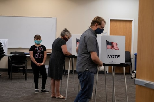 Voters cast their ballots at Dona Ana County Government Center during the New Mexico primary in Las Cruces, New Mexico, U.S., June 2, 2020.  REUTERS/Paul Ratje