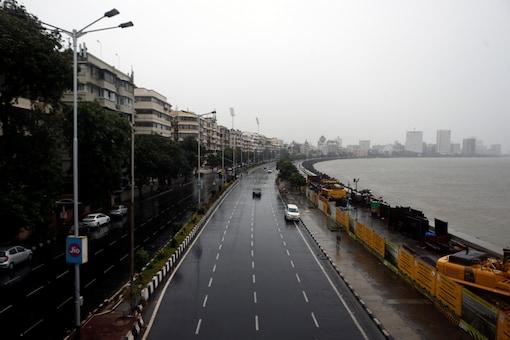A deserted road is seen at Marine Drive before cyclone Nisarga makes its landfall, in Mumbai, India, June 3, 2020. REUTERS/Francis Mascarenhas