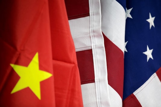 Flags of US and China are displayed at American International Chamber of Commerce (AICC)'s booth during China International Fair for Trade in Services in Beijing, China, May 28, 2019. REUTERS/Jason Lee/Files