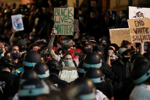 For representation: Demonstrators gather during a protest against the death in Minneapolis police custody of George Floyd, in the Manhattan borough of New York City, US, 2020. REUTERS