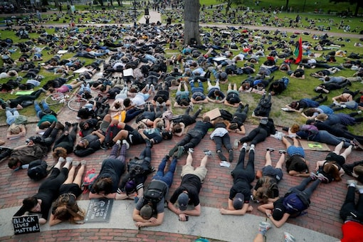 """People take part in a """"die-in"""" during a protest following the death in Minneapolis police custody of George Floyd, in Boston, Massachusetts, US.(Image: Reuters)"""
