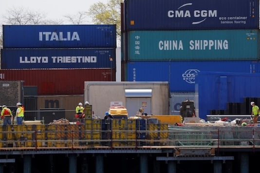"FILE PHOTO: Shipping containers, including one labelled ""China Shipping"" and another ""Italia,"" are stacked at the Paul W. Conley Container Terminal in Boston, Massachusetts, U.S., May 9, 2018.   REUTERS/Brian Snyder"