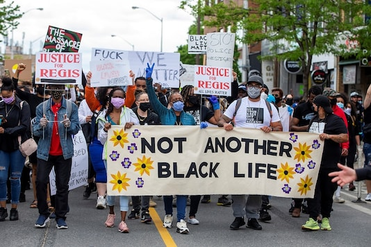 For representation: People march to highlight the deaths in the U.S. of Ahmaud Arbery, Breonna Taylor and George Floyd, and of Toronto's Regis Korchinski-Paquet, who died after falling from an apartment building while police officers were present, in Toronto, Ontario, Canada. (AP)
