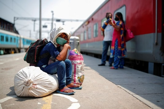 A child sits on luggage at a platform as he waits to board a train at a railway station after a few restrictions were lifted during an extended nationwide lockdown to slow the spread of the coronavirus disease (COVID-19), in New Delhi, India, June 1, 2020. REUTERS/Adnan Abidi