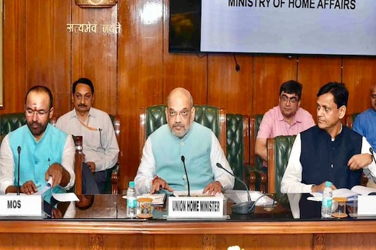 File photo of Union home minister Amit Shah with the junior ministers and officials,