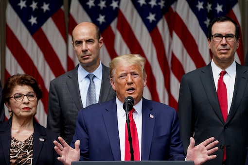 U.S. President Donald Trump talks about a U.S. jobs report amid the coronavirus disease (COVID-19) pandemic as he addresses a news conference as members of his administration listen in the Rose Garden at the White House in Washington, U.S., June 5, 2020. REUTERS/Kevin Lamarque