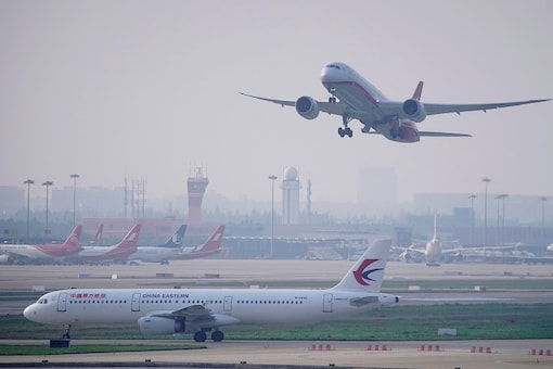 A China Eastern Airlines aircraft and  Shanghai Airlines aircraft are seen in Hongqiao International Airport in Shanghai, following the coronavirus disease (COVID-19) outbreak, China June 4, 2020. REUTERS/Aly Song