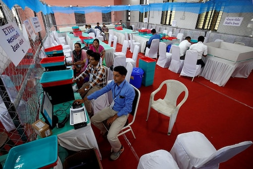 Election staff members work on their computers in a vote counting centre in Ahmedabad. (Reuters)