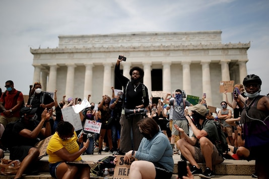FILE PHOTO: Demonstrators gather at the Lincoln Memorial during a protest against racial inequality in the aftermath of the death in Minneapolis police custody of George Floyd, in Washington, U.S. REUTERS/Carlos Barria/File Photo
