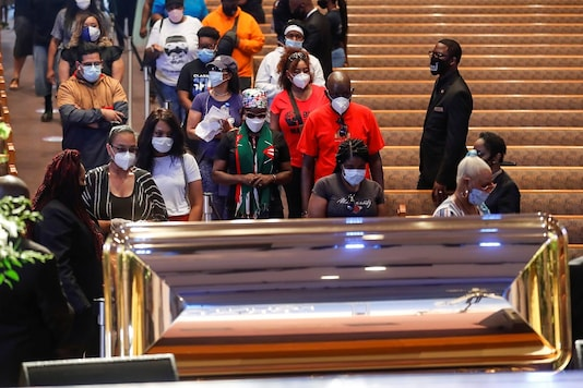 Mourners wait to visit the casket of George Floyd during a public visitation at The Fountain of Praise church in Houston. (Reuters)