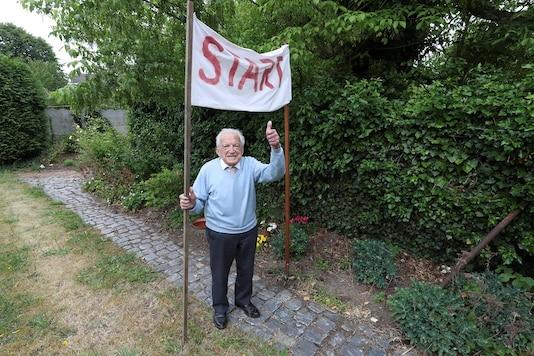 103-year-old Belgian oldest former general practitioner Alfons Leempoels poses next to a start line. REUTERS/Yves Herman