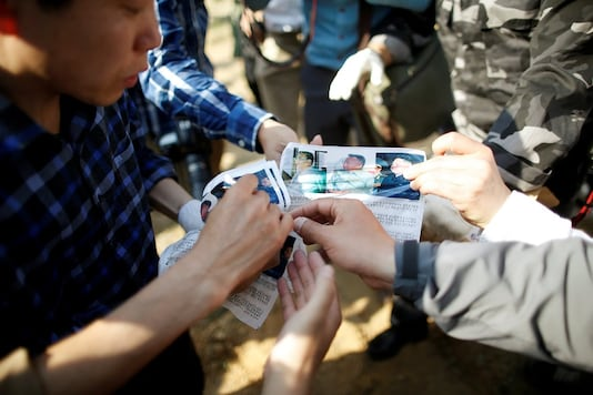 FILE PHOTO: Park Sang-hak, a North Korean defector and leader of an anti-North Korea civic group, shows leaflets denouncing North Korean leader Kim Jong Un to the media, near the demilitarized zone in Paju, South Korea, April 29, 2016.  REUTERS/Kim Hong-Ji/File Photo