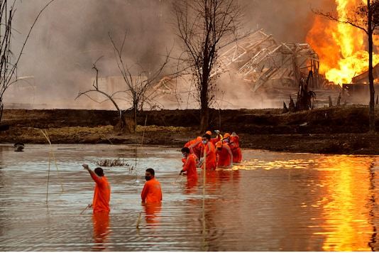 File photo of NDRF personnel at the site of the oil well blowout in Assam's Tinsukia. (AP)