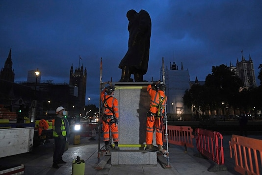 Scaffolders erect boarding around the statue of Sir Winston Churchill at Parliament Square, in London, Thursday. (Kirsty O'Connor/PA via AP)