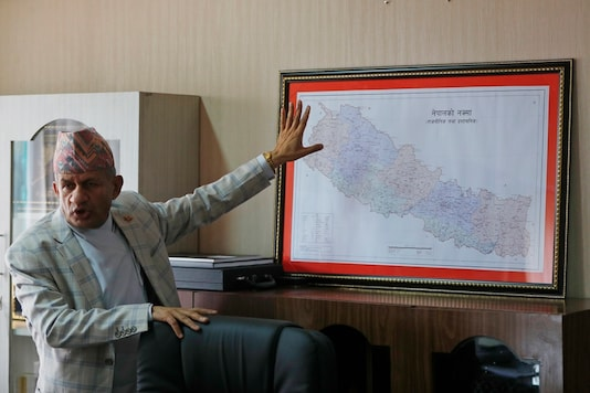 Nepal's Foreign Minister Pradeep Gyawali points to a map of Nepal. (AP)
