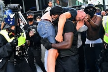 A Picture and Its Story: Black Man Carries Suspected Far-right Protester to Safety