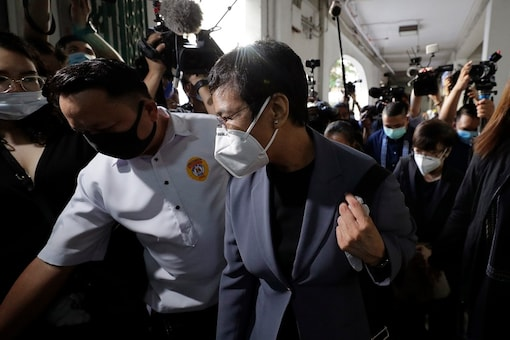 Rappler CEO and Executive Editor Maria Ressa, front right, wearing a protective mask, is escorted as she arrives to attend a court hearing at Manila Regional Trial Court, Philippines on Monday June 15, 2020. Ressa's verdict is expected to be announced Monday for a cyber libel case. (AP Photo/Aaron Favila)